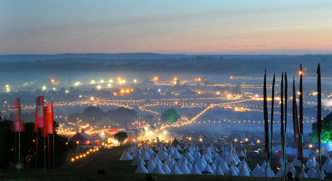 The sun rising on the nearly city-sized Glastonbury site in 2009