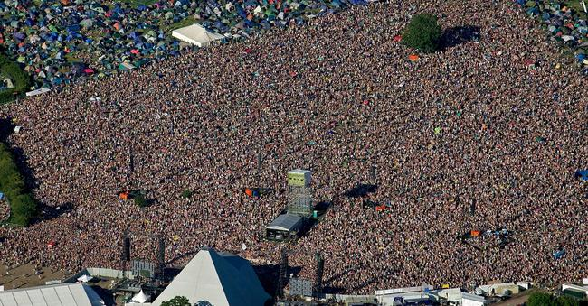 The crowd at the Pyramid Stage on day 4 of Glastonbury Festival 2011