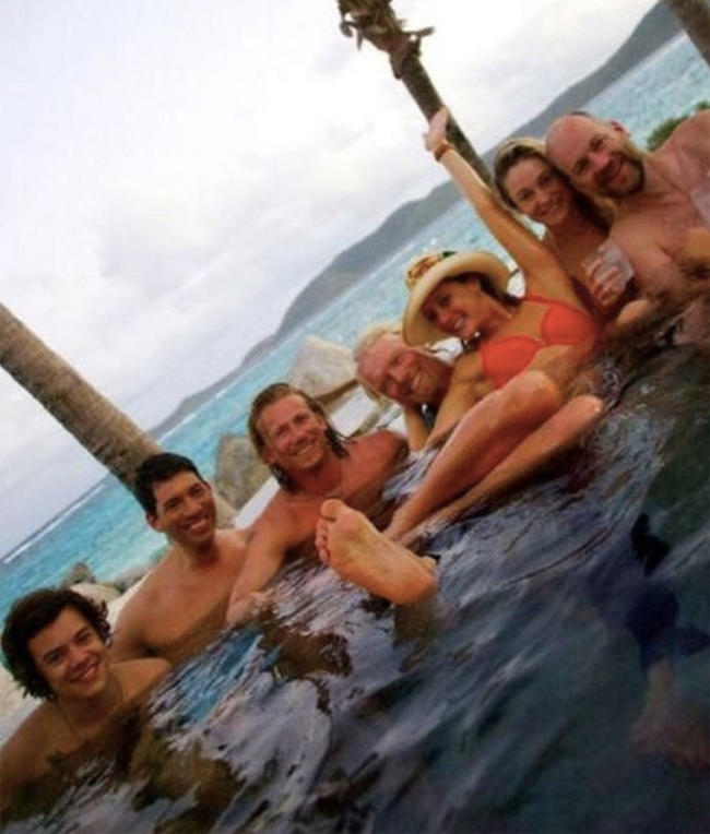 Harry Styles hanging out in a hot tub on Richard Branson's necker island.