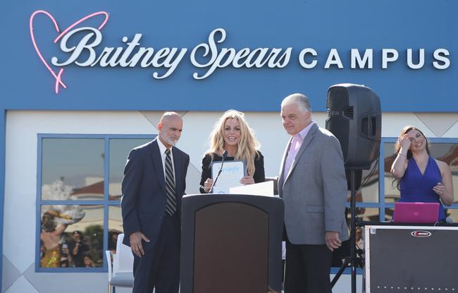 Nevada Childhood Cancer Foundation President and CEO Jeff Gordon and singer Britney Spears are presented a proclamation by Clark County Commissioner Steve Sisolak during the grand opening of the Nevada Childhood Cancer Foundation Britney Spears Campus on November 4, 2017 in Las Vegas, Nevada