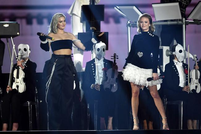 Anne-Marie and Zara Larsson perform with Clean Bandit at the 2017 MTV Europe Music Awards in London, England in November 2017