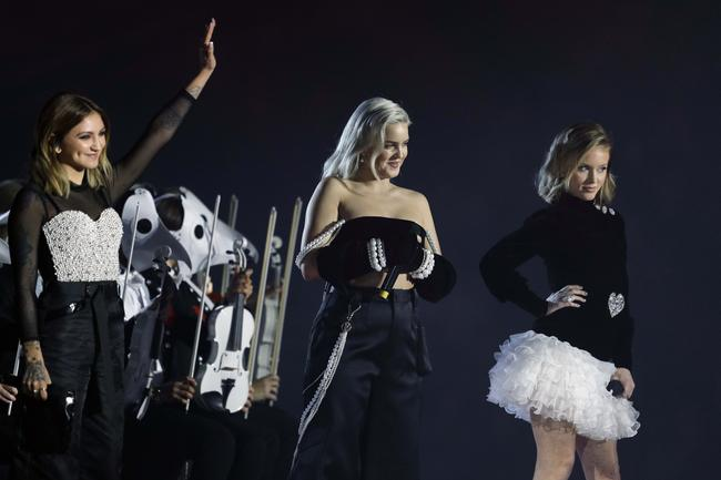 Julia Michaels, Anne-Marie and Zara Larsson perform with Clean Bandit at the 2017 MTV Europe Music Awards in London