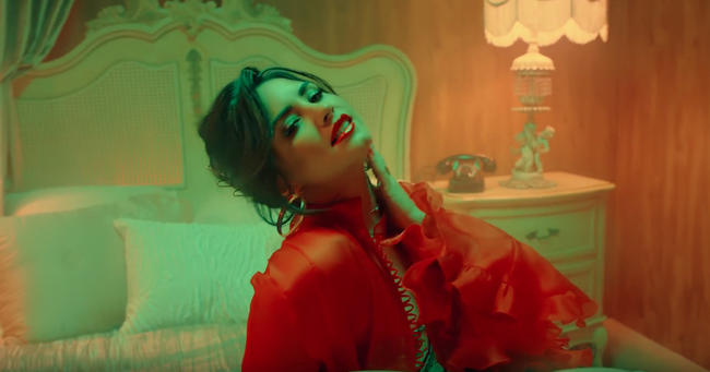 Demi Lovato in the video for 'Échame La Culpa' with Luis Fonsi