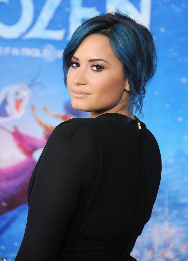 Demi Lovato arrives at the Los Angeles Premiere 'Frozen' on November 19, 2013 at the El Capitan Theatre in Hollywood, California
