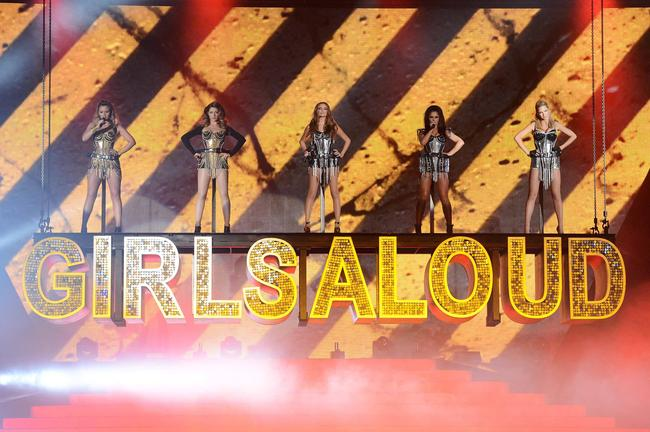 Kimberley Walsh, Nicola Roberts, Nadine Coyle, Cheryl Cole and Sarah Harding of Girls Aloud perform on stage on the first night of their 'Girls Aloud - The Hits Tour 2013' tour, at the Metro Radio Arena on February 21, 2013 in Newcastle, United Kingdom