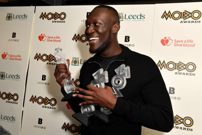 Stormzy with his awards at the 2017 MOBO Awards