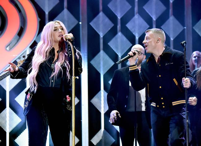 Kesha (L) and Macklemore perform onstage during 102.7 KIIS FM's Jingle Ball 2017 presented by Capital One at The Forum on December 1, 2017 in Inglewood, California