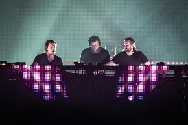 Axwell, Sebastian Ingrosso and Steve Angello from Swedish House Mafia perform at Palais Omnisports de Bercy on December 8, 2012 in Paris, France