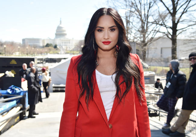 Demi Lovato 'awake and responsive' after hospitalisation for suspected drug overdose