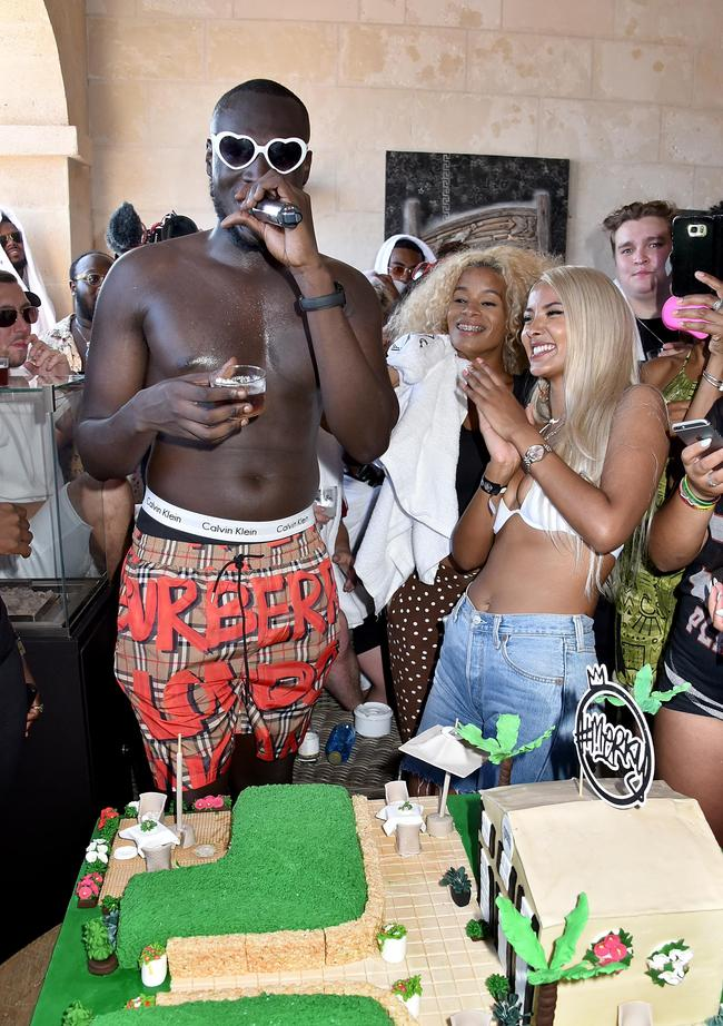 utting his cake, as Spotify Premium throws the ultimate party in Spain for Stormzy's 25th birthday on July 26, 2018 in Menorca, Spain