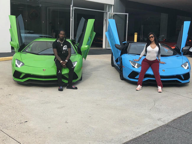 Cardi B and Offset pose with their matching cars, July 2018, on Twitter