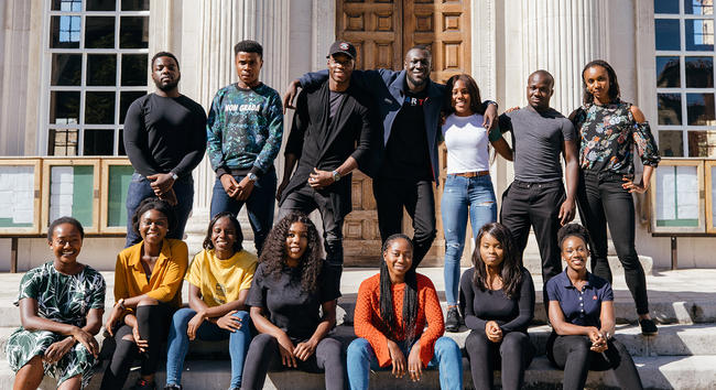 Stormzy with Cambridge University students outside Senate House, Cambridge University