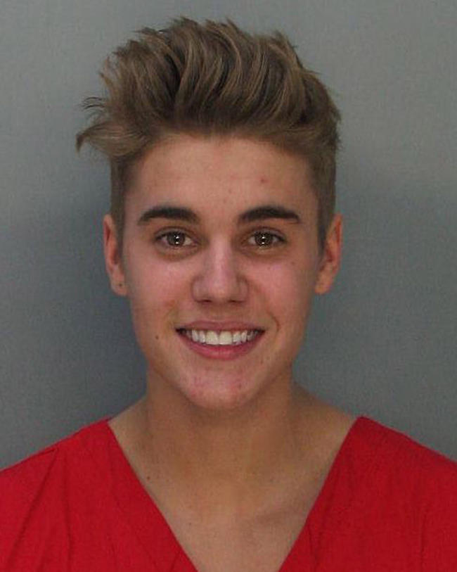 In this handout photo provided by Miami-Dade Police Department, pop star Justin Bieber poses for a booking photo at the Miami-Dade Police Department on January 23, 2014 in Miami, Florida. Justin Bieber was charged with drunken driving, resisting arrest and driving without a valid license after Miami Beach Police found the pop star street racing on Thursday morning. (Photo by Miami-Dade Police Department via Getty Images)