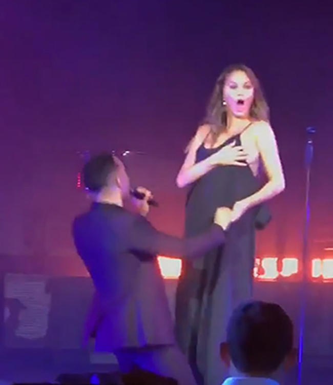 Chrissy Teigen Suffers Wardrobe Malfunction As She Flashes Her Front To Audience