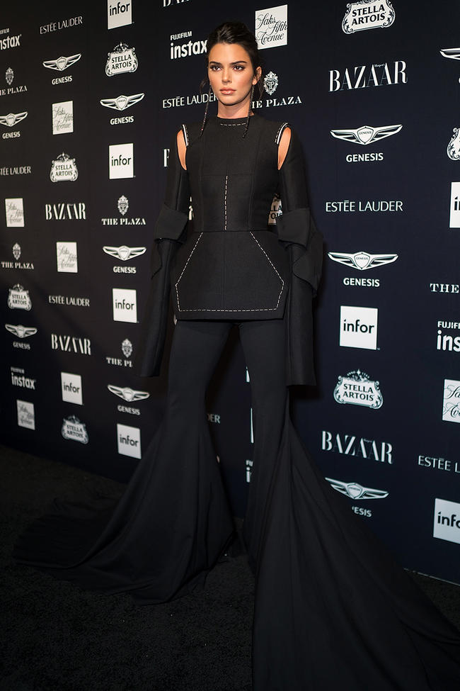 Bella Hadid and Kendall Jenner compete for most bizarre outfit at Harper's Bazaar party