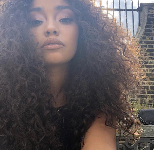 Perrie Edwards and Leigh-Anne Pinnock of Little Mix embrace their freckles and natural afro hair to encourage all to own their insecurities, 2018