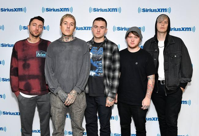Keyboardist Jordan Fish, lead vocalist Oliver Sykes, drummer Matt Nicholls, guitarist Lee Malia and bassist Matt Kean of rock band 'Bring Me The Horizon' visit SiriusXM Studios on October 4, 2018 in New York City.