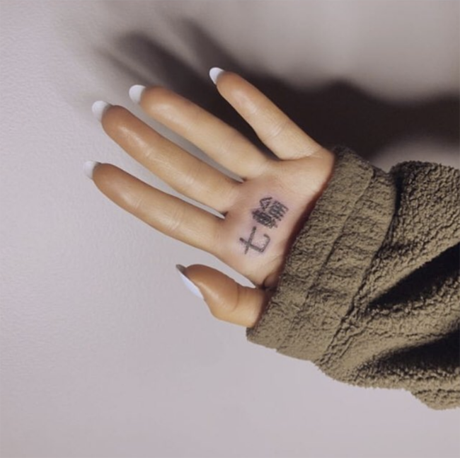 Ariana Grande reacts after fans notice she's mistranslated her tattoo